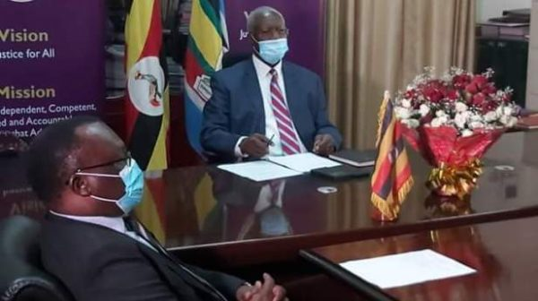 Justice Katureebe hands over Office to Owiny Dollo