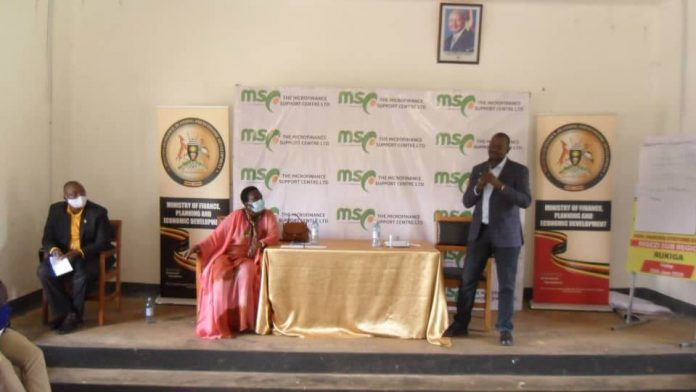Minister of State for Microfinance Hon Haruna Kyeyune Kasolo addressing Rukiga District leaders EMYOOGA